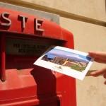 Postkarte im Briefkasten